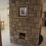 Fireplace With Built In Log Holder And Sandstone Frame Surround