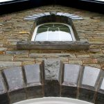 Sawn And Polished Limestone Arch With Textured Keystone