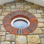 Round Window With Brick Detail