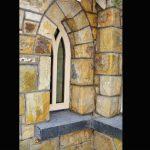 Rock Faced Limestone Cills. Arch Detail On Window