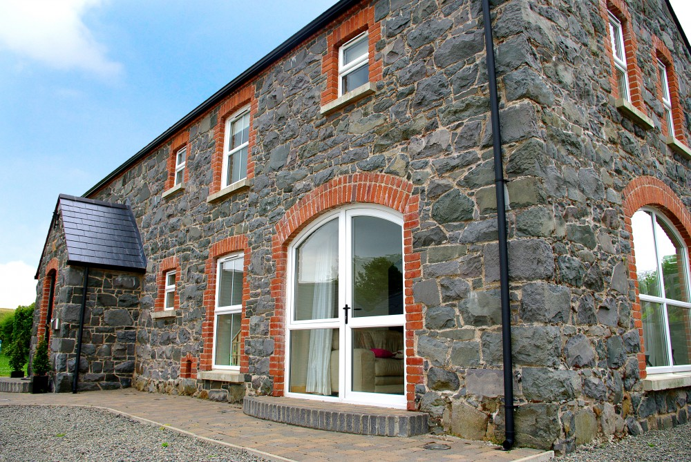 Charming Basalt Stone With Red Brick Quoins And Soldiers To Door And Windows