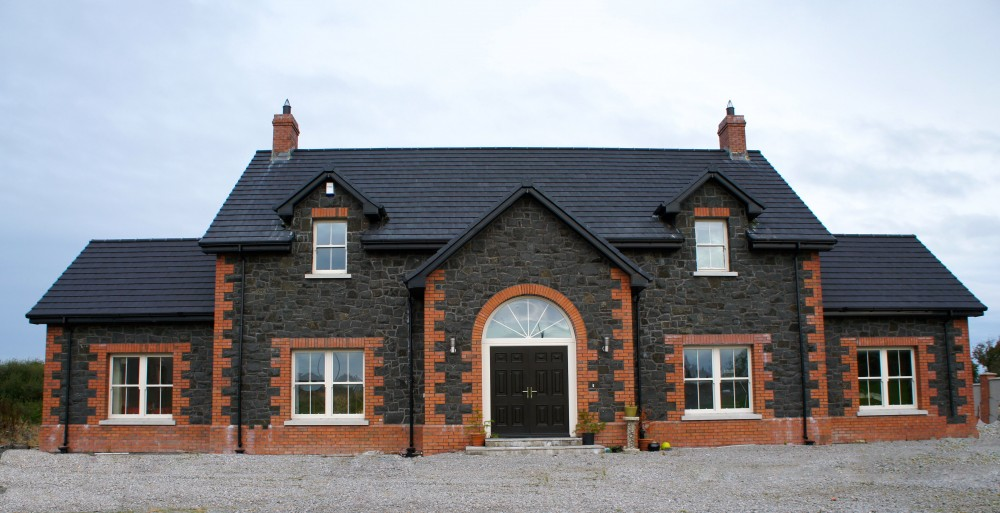 Split Basalt With Red Brick Quoins, Heads And Plinth