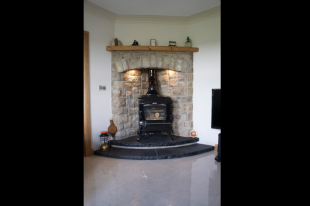 Tipperary Brown Corner Fireplace With Split Level Black Limestone Hearth