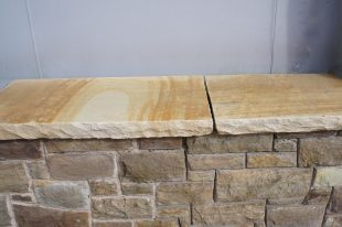 Rock Faced Sandstone Wall Coping