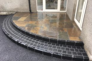 Olde English Slate Paving, With Black Limestone Cobbles And Black Limestone Kerb For Riser