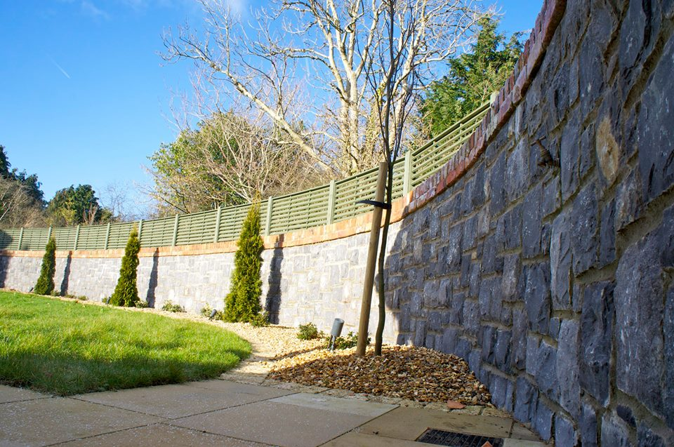 White Limestone curved wall with red brick wall copings