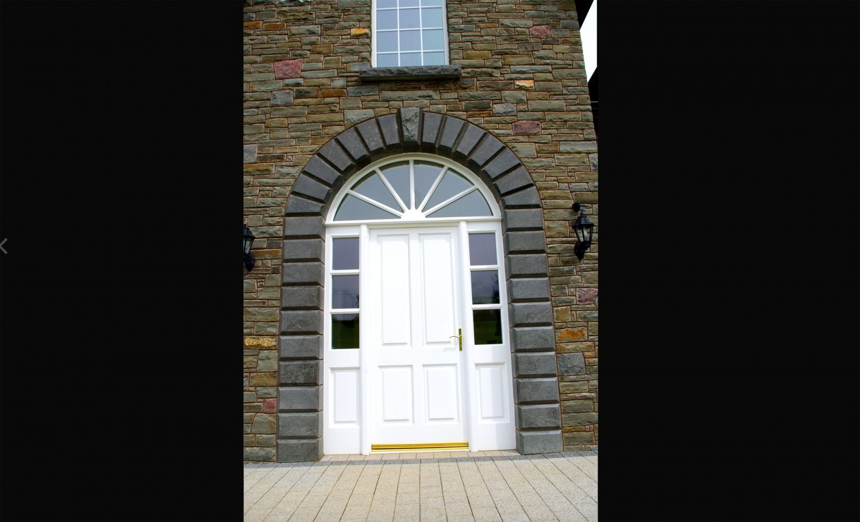 Cut and polished arched door surround
