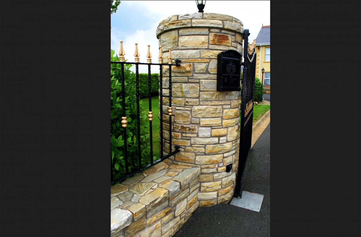 Round Pillar built with Brown Quartzite Stone, wall coping & pillar coping built from stone
