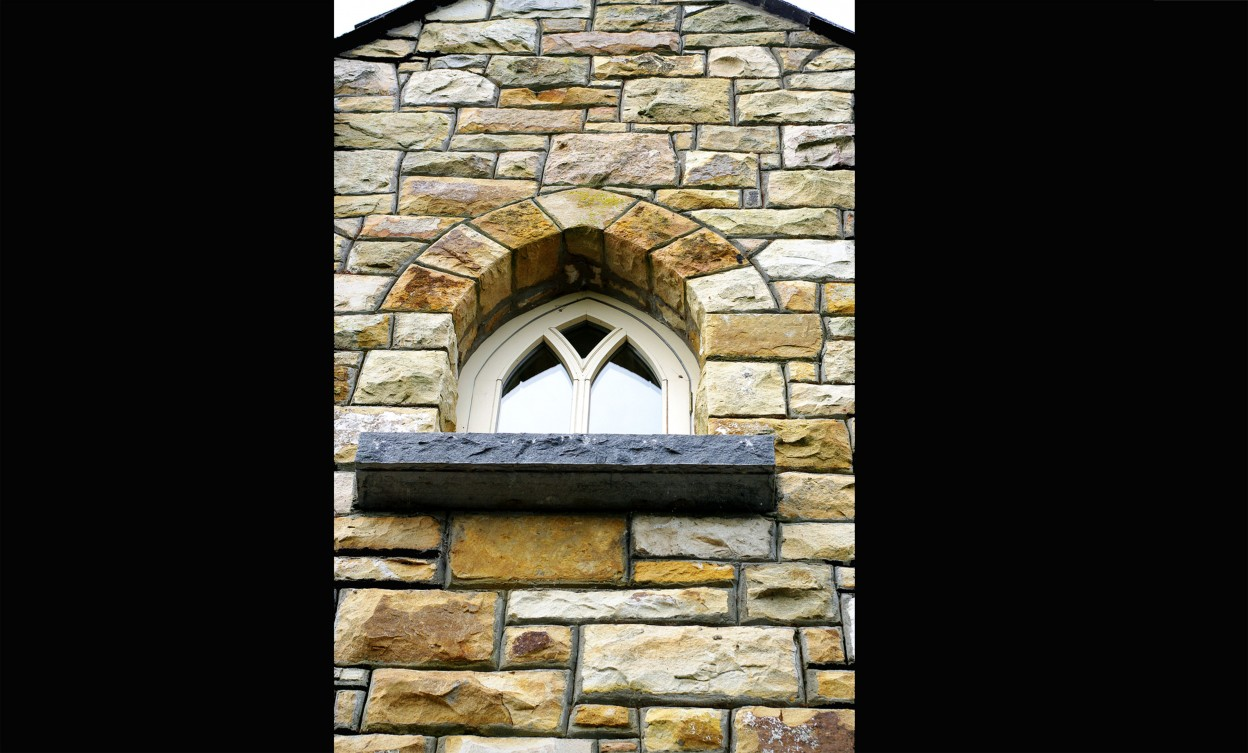 Gothic window arch with rock faced Kilkenny limestone window cill