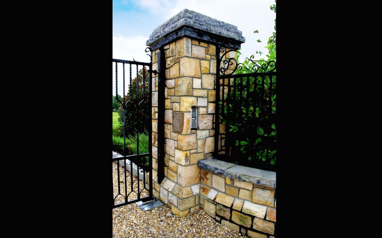 Reclaimed Leitrim Sandstone Pillar with recessed keypad, Plinth detail to pillar & wall, Rock faced limestone wall coping, rock faced limestone pillar coping. 200x100 Granite Kerbs
