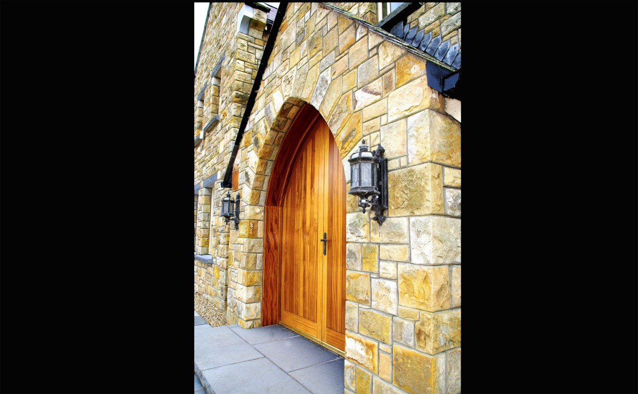 Free standing gothic door arch. Limestone steps