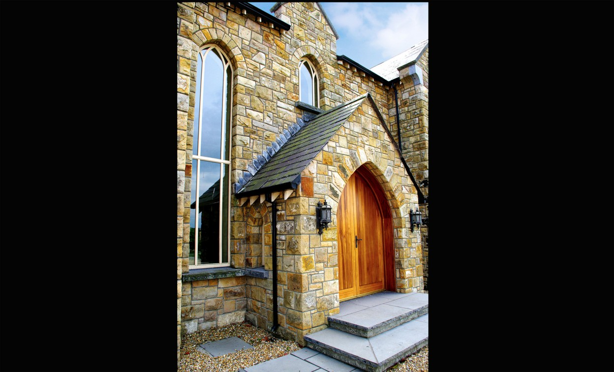 Reclaimed Leitrim sandstone. Freestanding arch on front door. Limestone path & steps