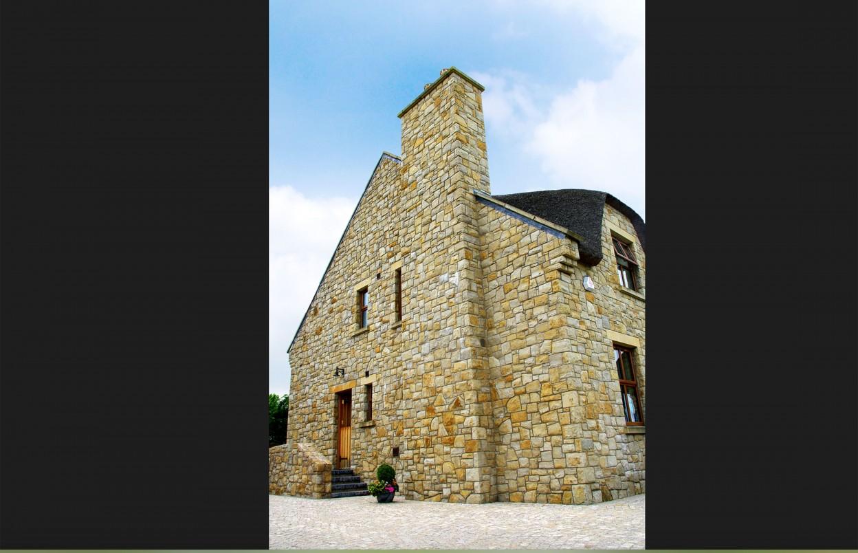 Donegal Sandstone. Brown granite cobbles