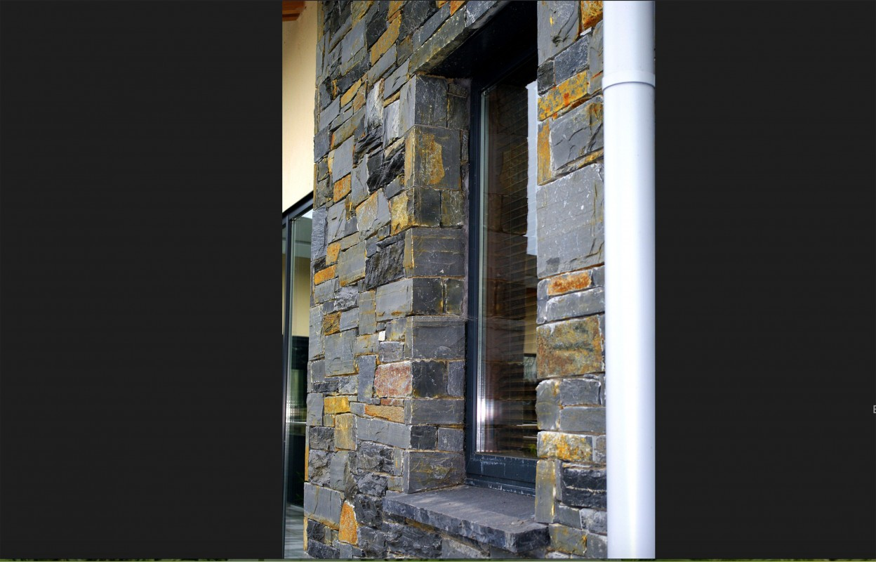 Donegal Slate. Limestone hearths cut as window cill. Stone built on keystone lintel