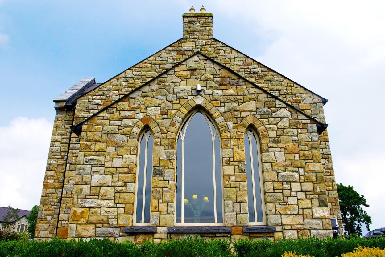 Reclaimed Leitrim Sandstone, Gothic window arches, Rock faced limestone cills