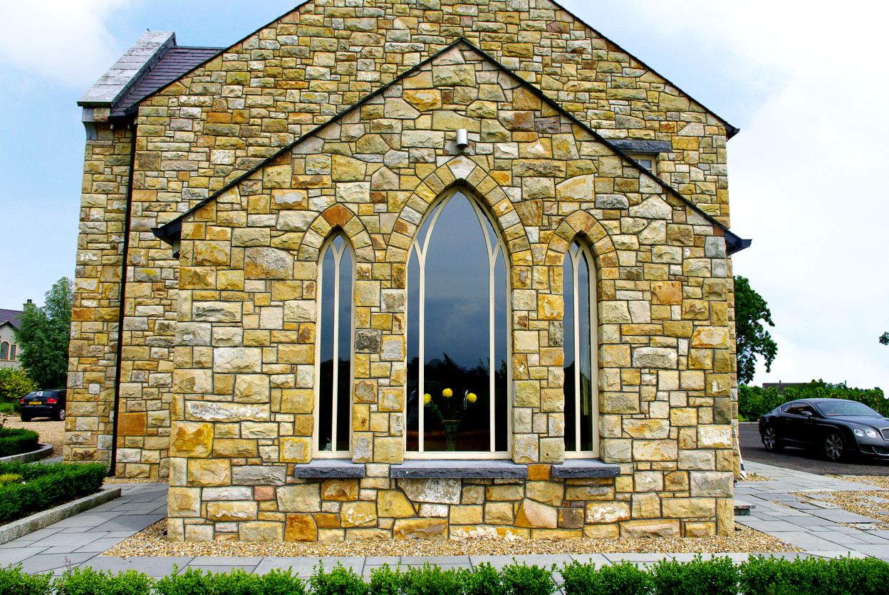 Reclaimed Leitrim Sandstone, Gothic window arches, Rock faced limestone cills
