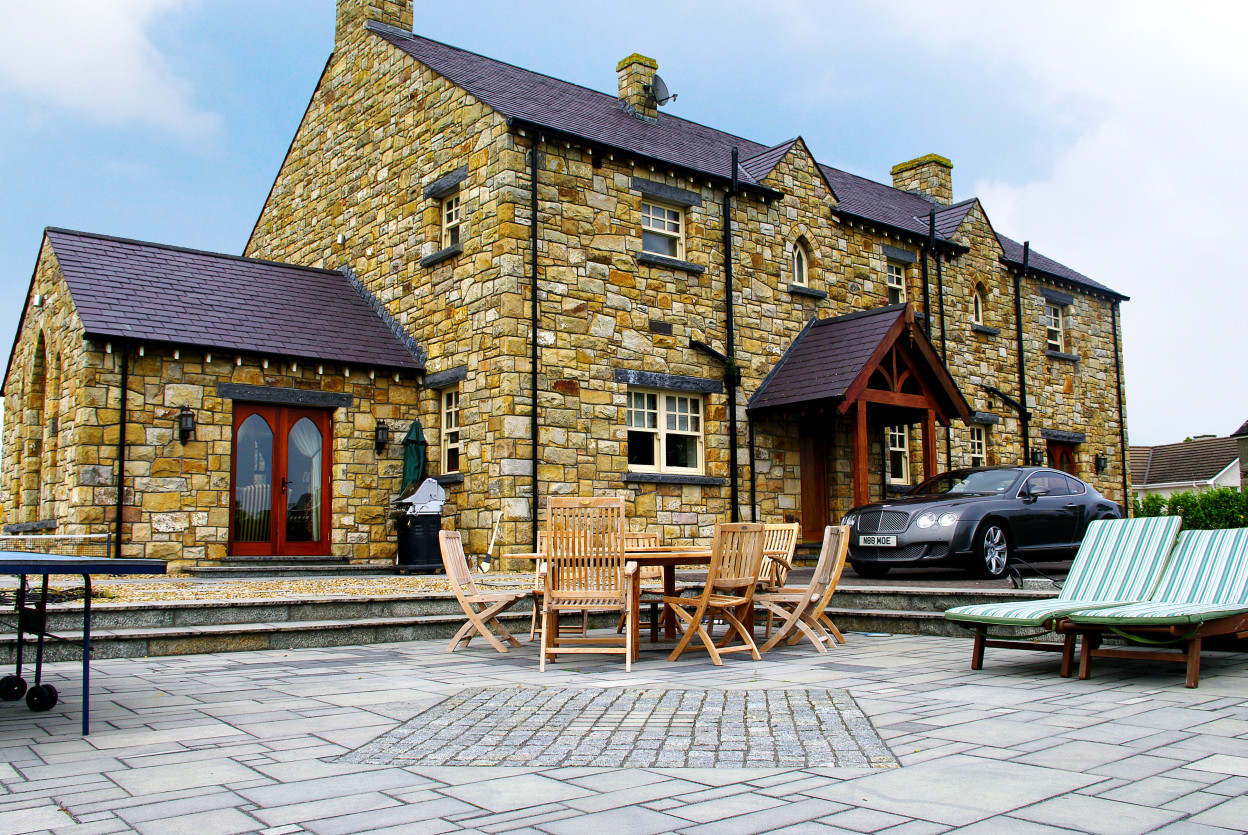 Reclaimed Leitrim Sandstone. Indian Limestone Paving with Granite Cobbles