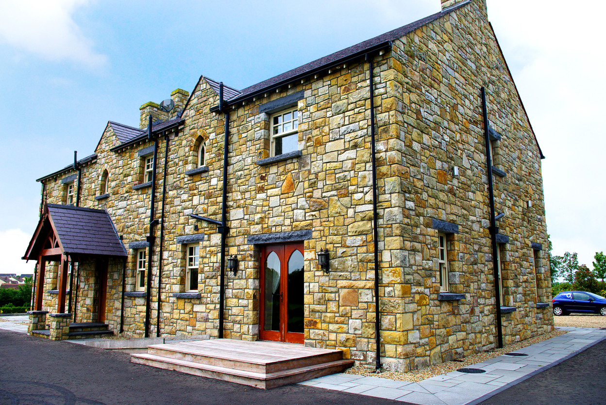 Reclaimed Leitrim Sandstone with Rock faced limestone cills and lintels
