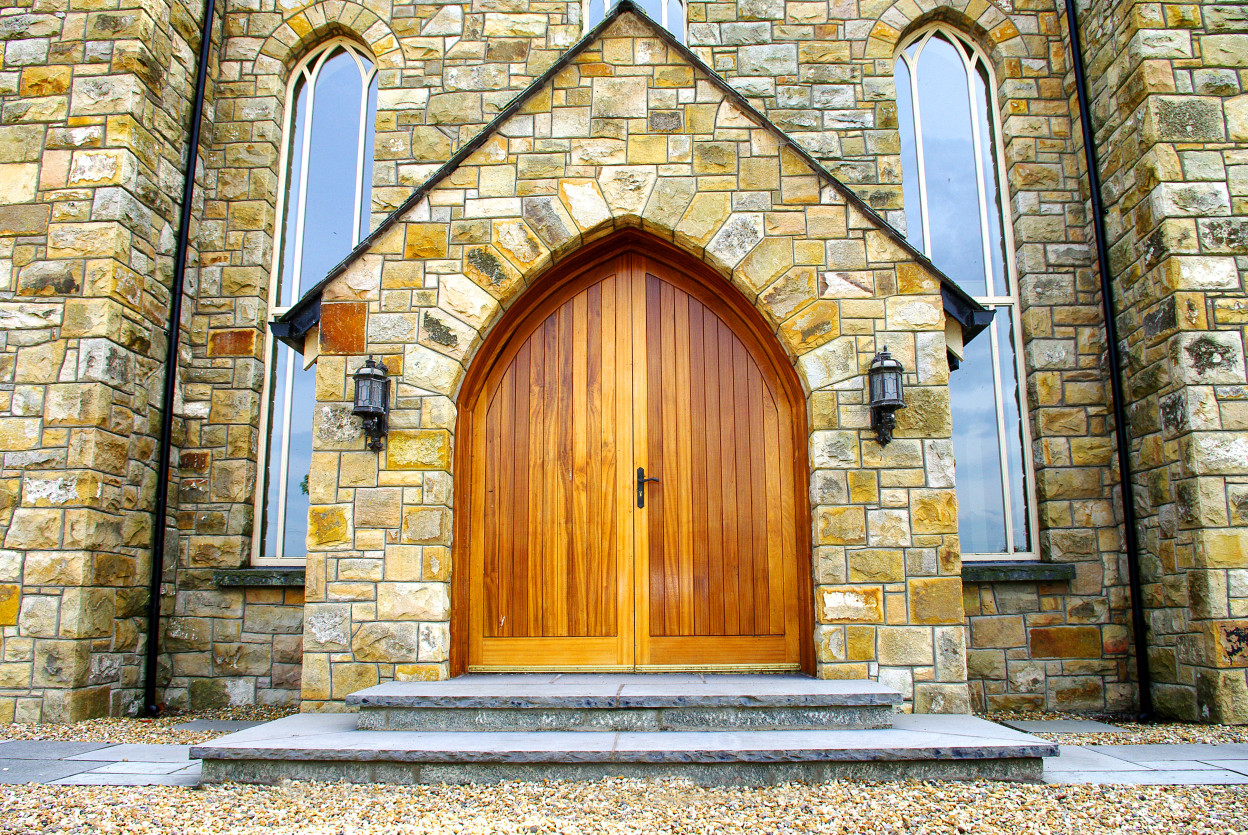 Gothic Door Arch, Ornate door arch, Rock faced limestone door step with granite risers