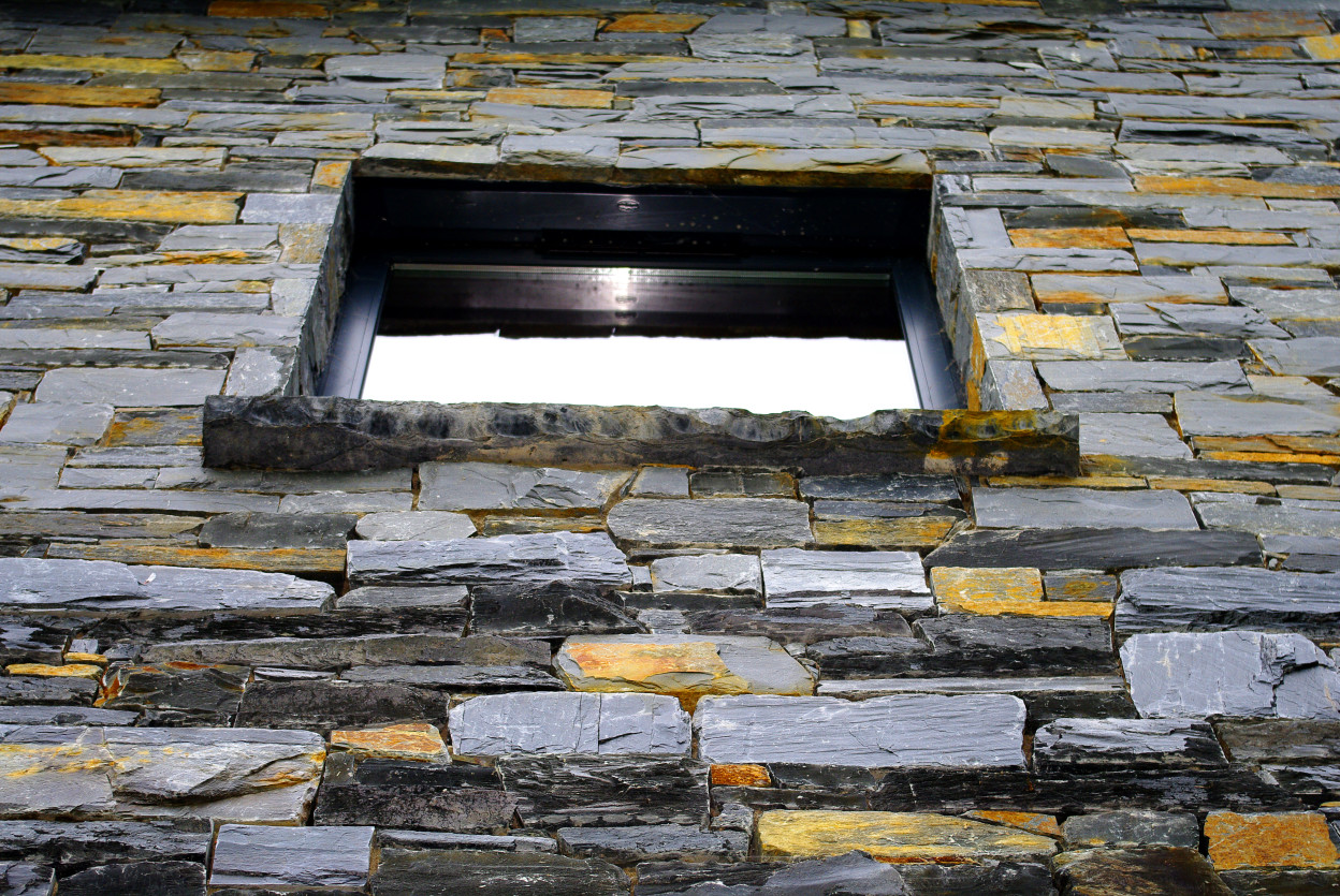 Donegal Slate Built on keystone lintel. Limestone Hearths cut as window cills