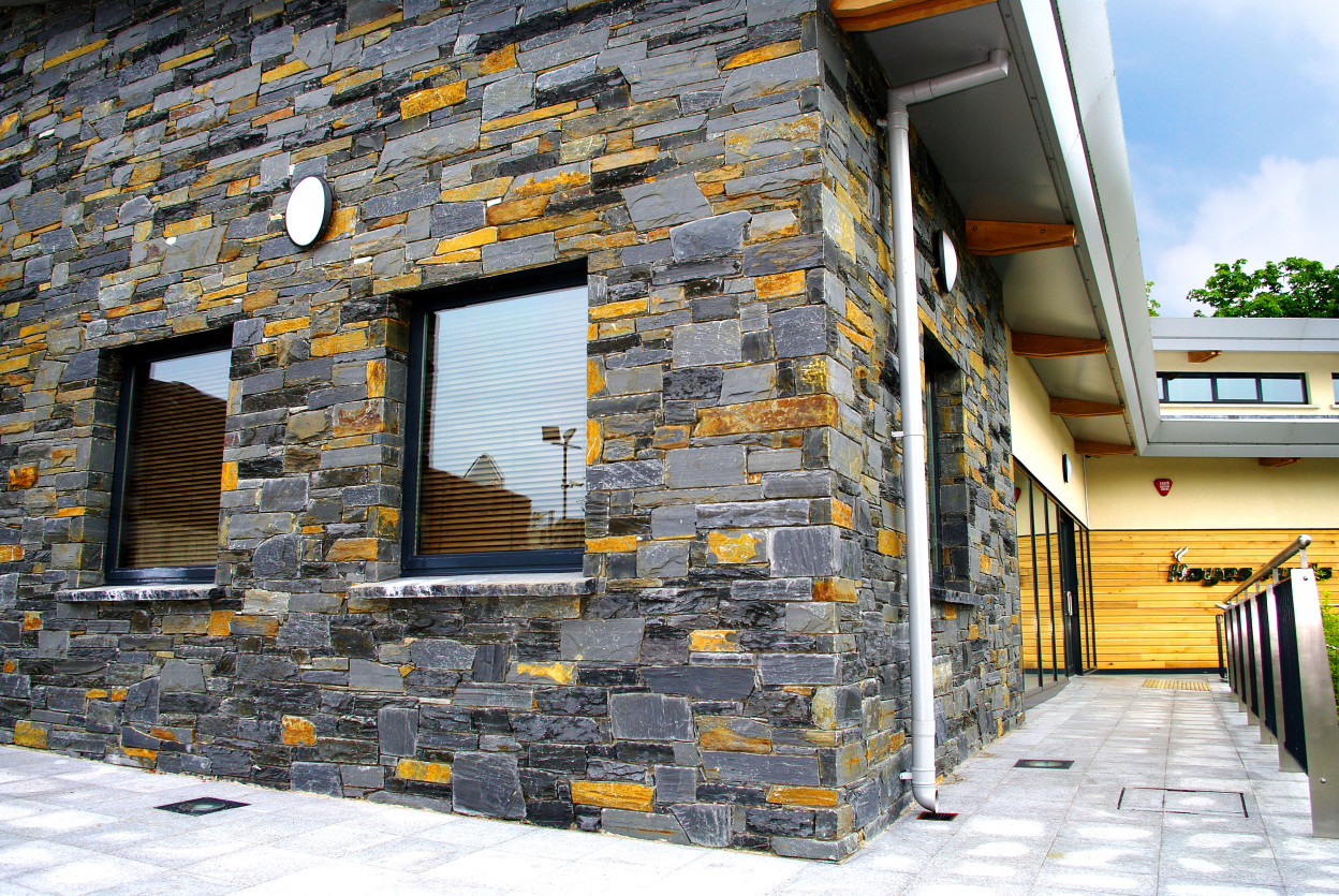 Donegal Slate with handpicked yellow stones chosen from quarry to match wooden cladding on building