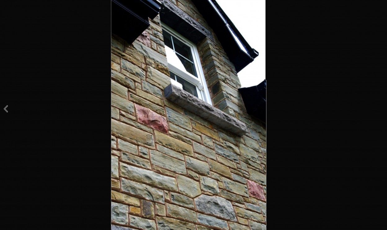 Rock faced limestone window cill and lintel
