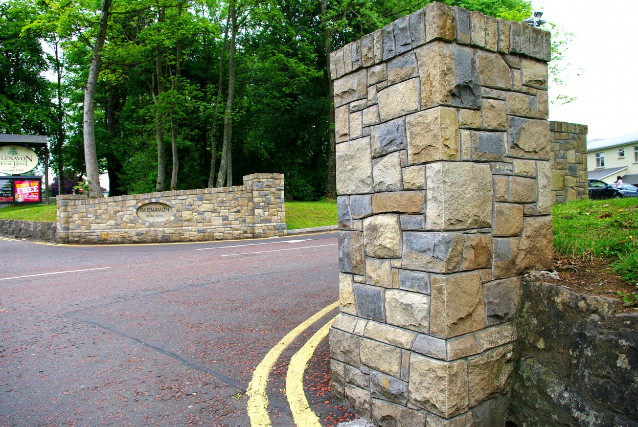 Donegal Sandstone with Blue Centred Sandstone pillar. Topped with 150mm high soldiers.