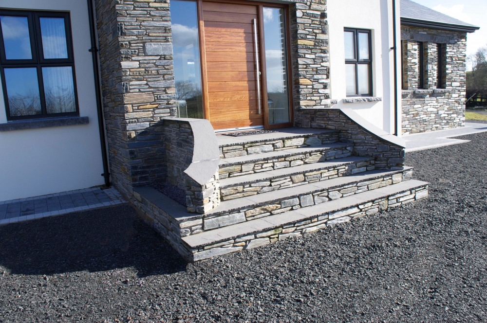 Steps formed with Donegal slate stone risers and 22mm calibrated limestone treads. Wall copings formed using 22mm limestone paving.