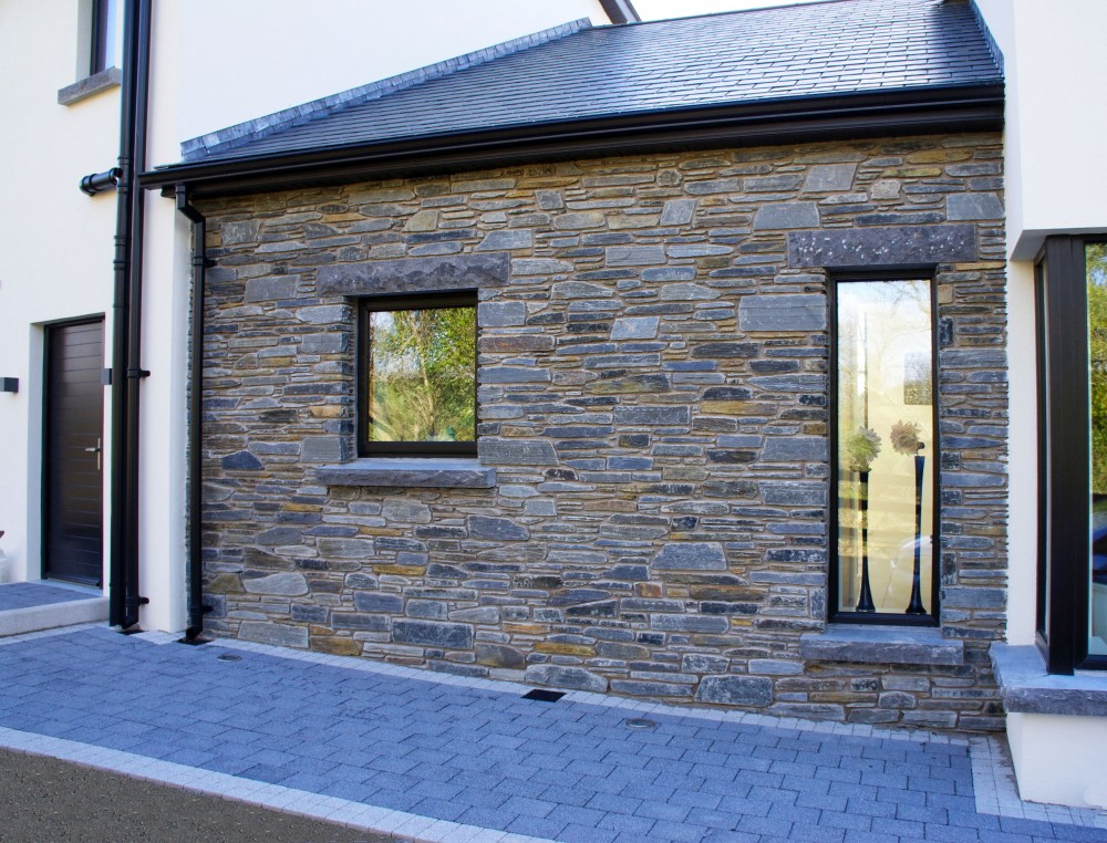 Donegal Slate with rock faced limestone window cills and lintels