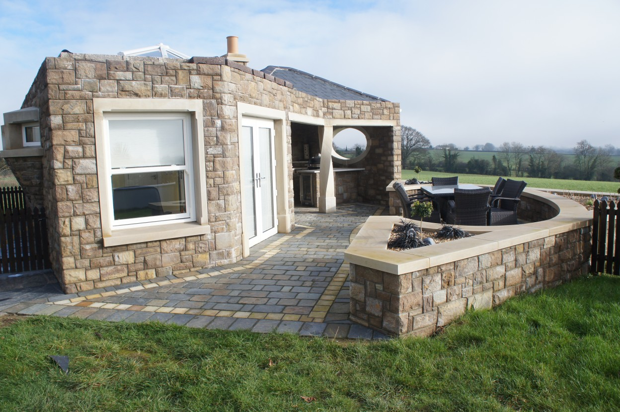 Summer house built in Tipperary brown sandstone with outdoor kitchen, BBQ and seating area