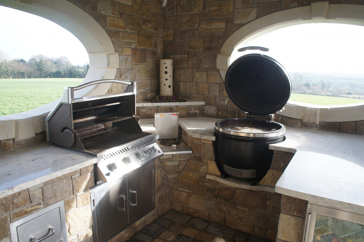 Outdoor kitchen with BBQ & Smoker. Granite worktop supplied by Elite Granite. Donegal sandstone oval window surround