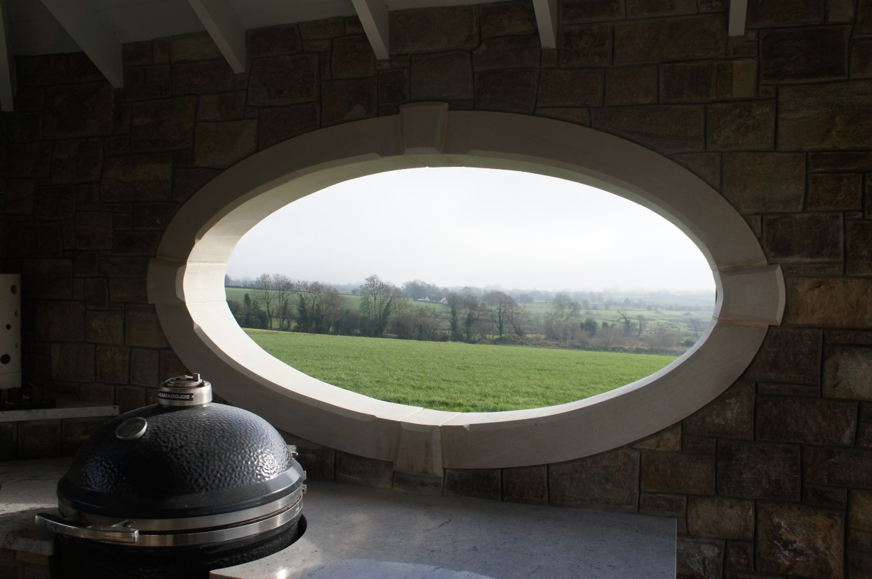Hand carved Donegal sandstone oval window surround