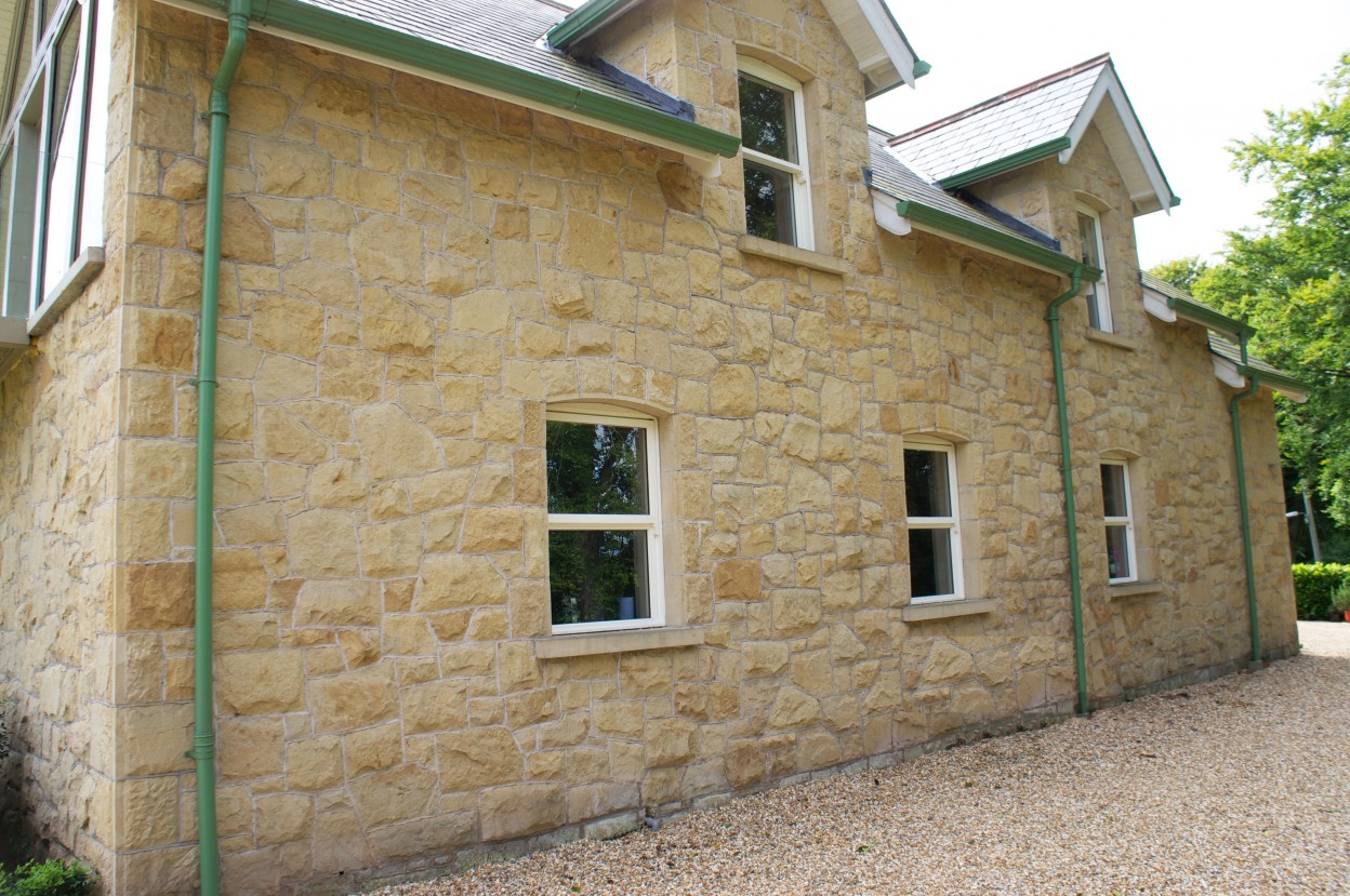 Carland Sandstone with chiseled draught margin to corner quoins and window & door reveals
