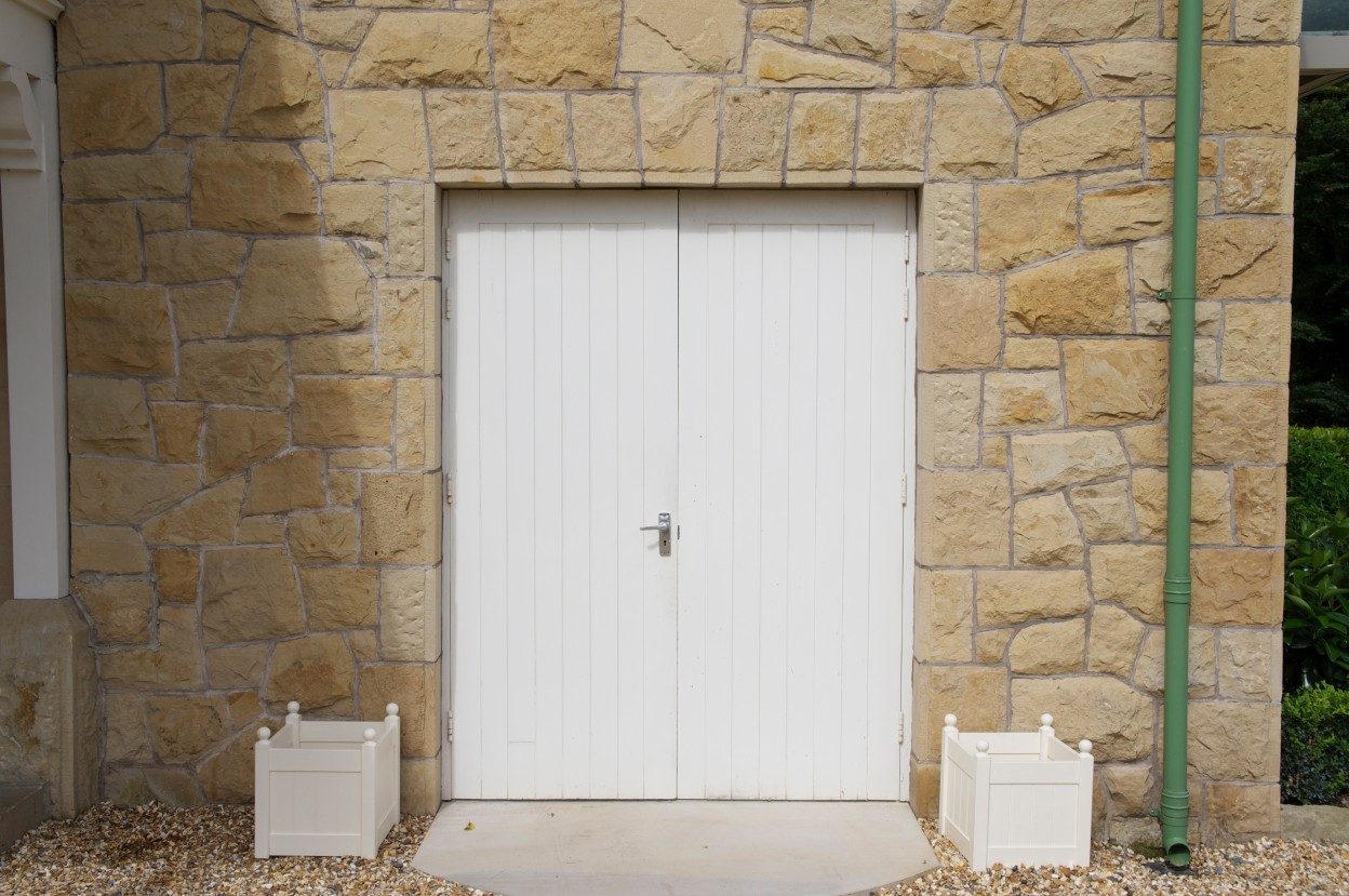 Carland Sandstone with chiseled draught margin to door reveals