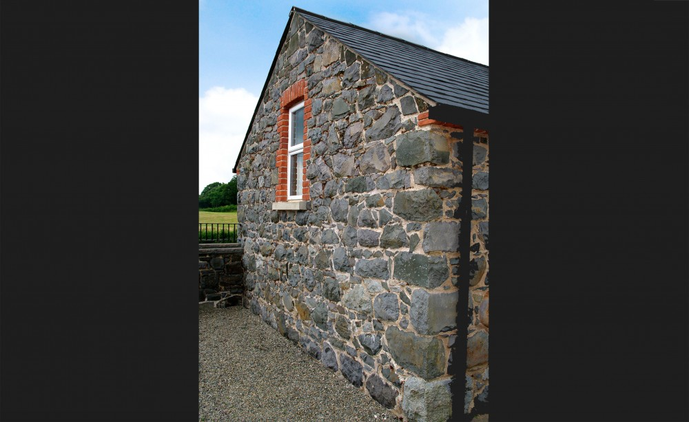 Basalt Barn restored, sandblasted and repointed. Red brick quoin detail & soldiers to window