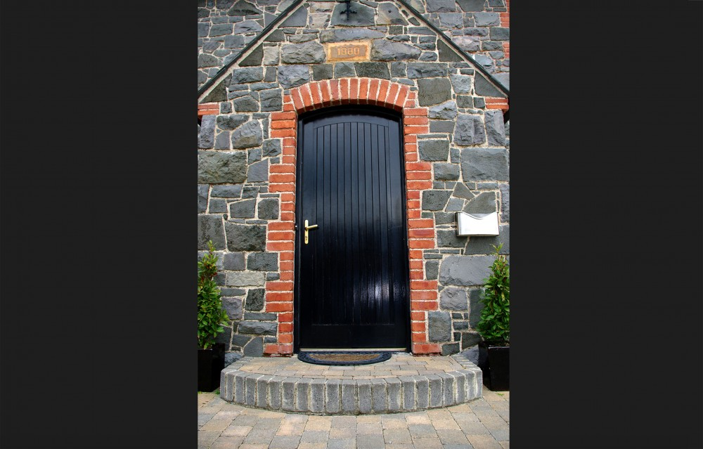 Basalt Barn restored, sandblasted and repointed. Red brick quoins and soldiers to door. Date stone carved with date of original building