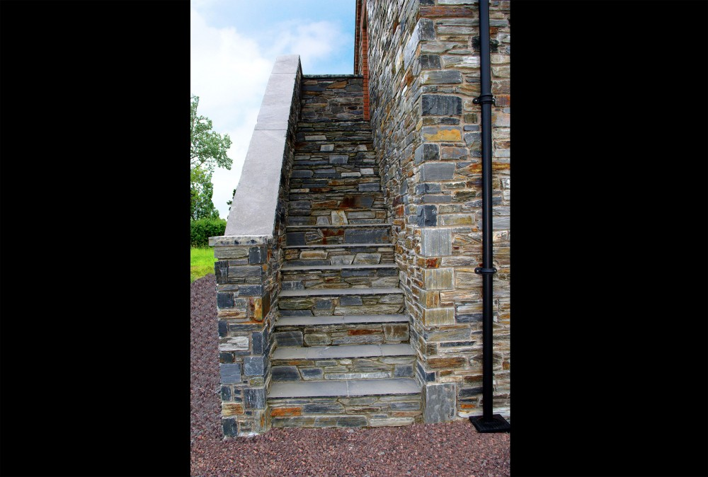 Donegal slate external stairs. 22mm calibrated limestone paving used to form step with Donegal slate risers. 60mm limestone hearths used to form wall coping