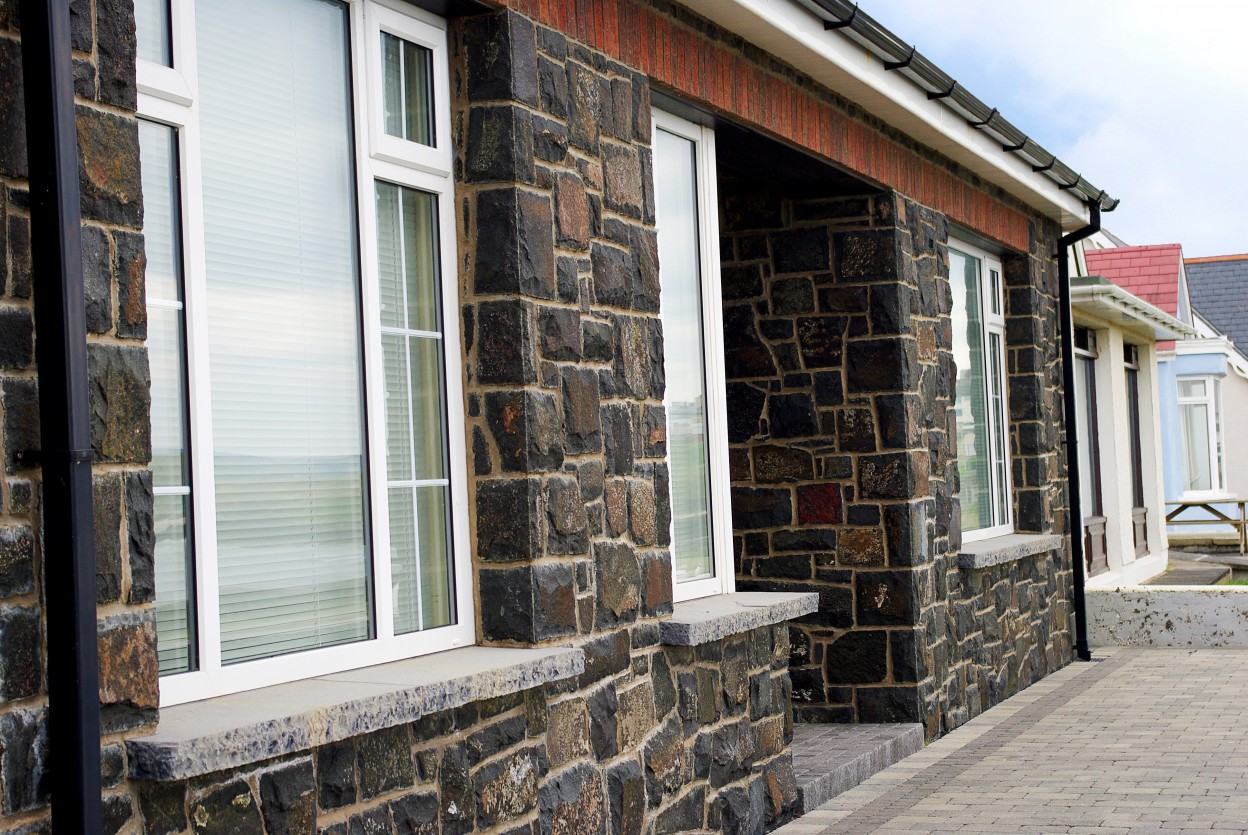 Natural face basalt with rock faced limestone window cills