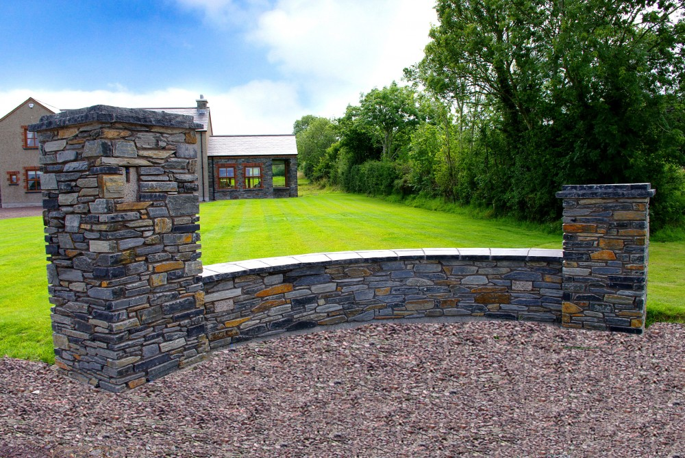 Donegal slate entrance pillar with double layer pillar coping. 60mm limestone hearths cut to form wall copings