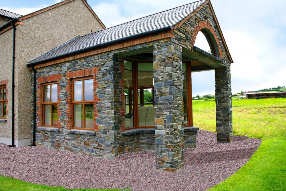 Donegal slate with 70% brown mix. Red brick quoins and soldiers built on a keystone lintel. Limestone hearths cut into window cills