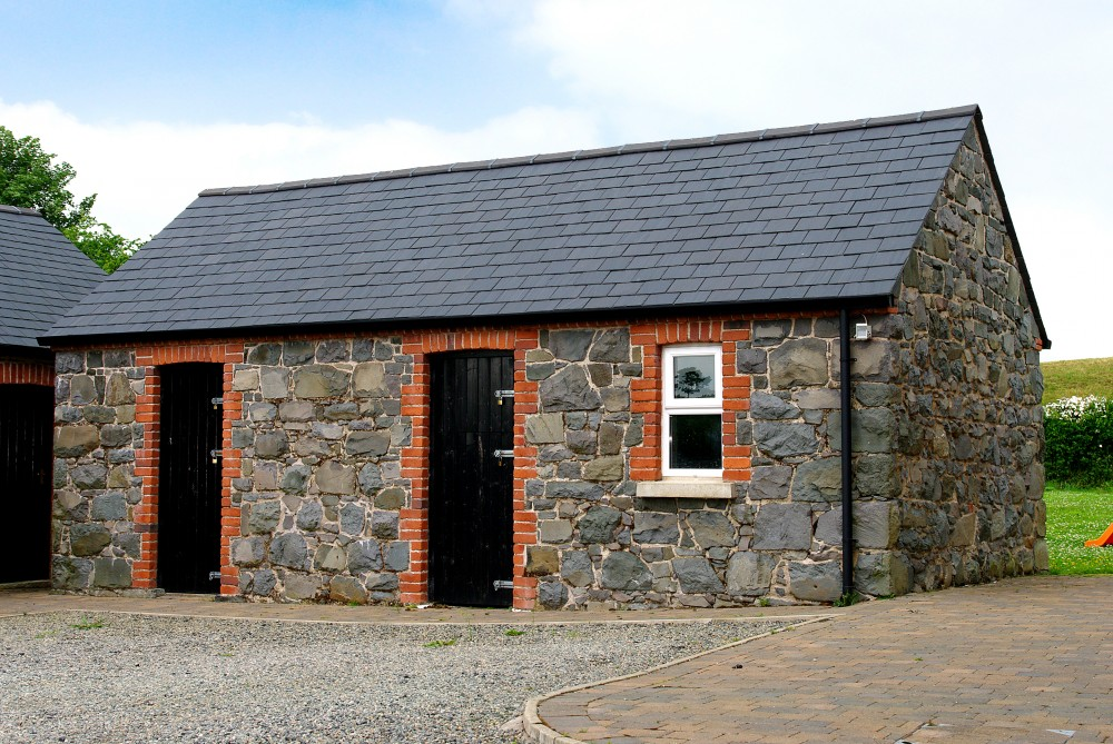 Basalt Barn restored, sandblasted and repointed. Red brick quoin detail & soldiers to windows and doors.