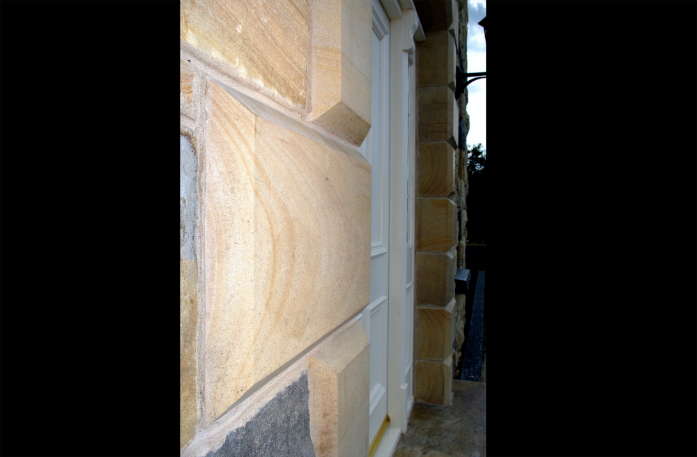 Sandstone quoin detail to door