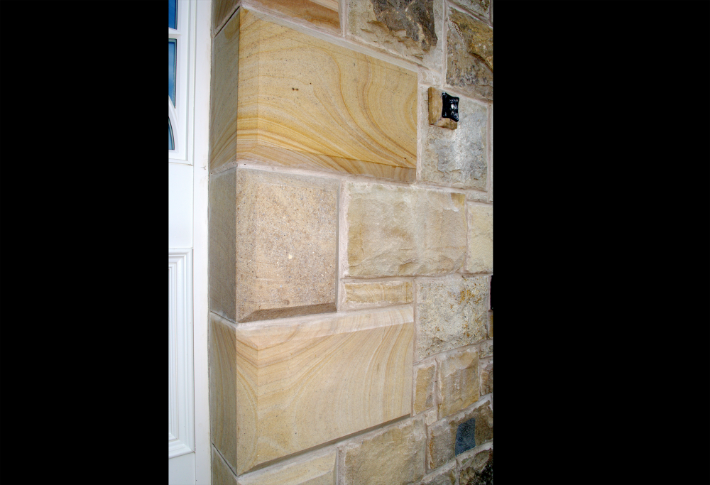 Sandstone quoin detail to door. Good example of the natural beauty of stone with the grain running through the stone