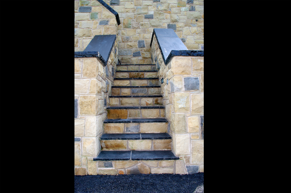 Exterior steps with limestone hearths used to form wall coping. Limestone paving used to form treads.