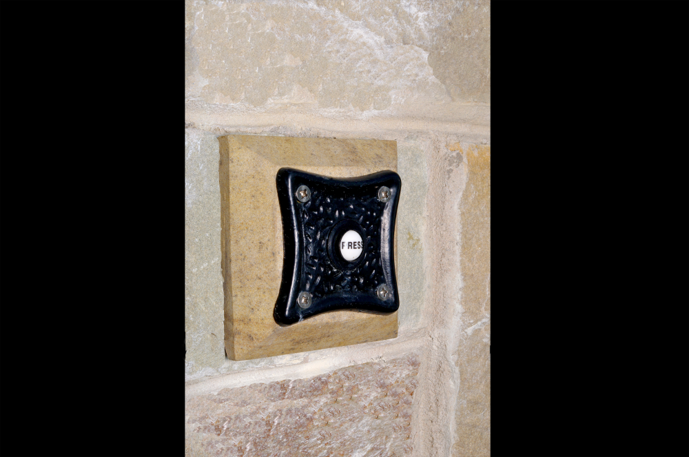 Door bell with stone surround