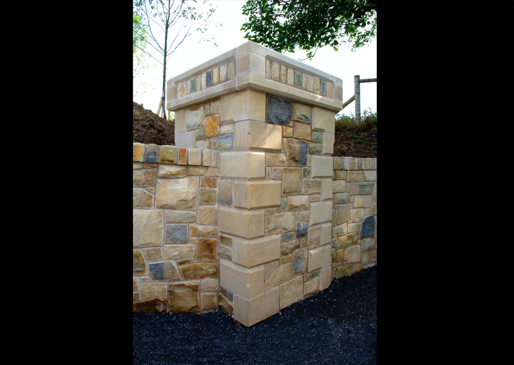 Chamfered sandstone quoins on pillar. Cut stone detail to pillar caps