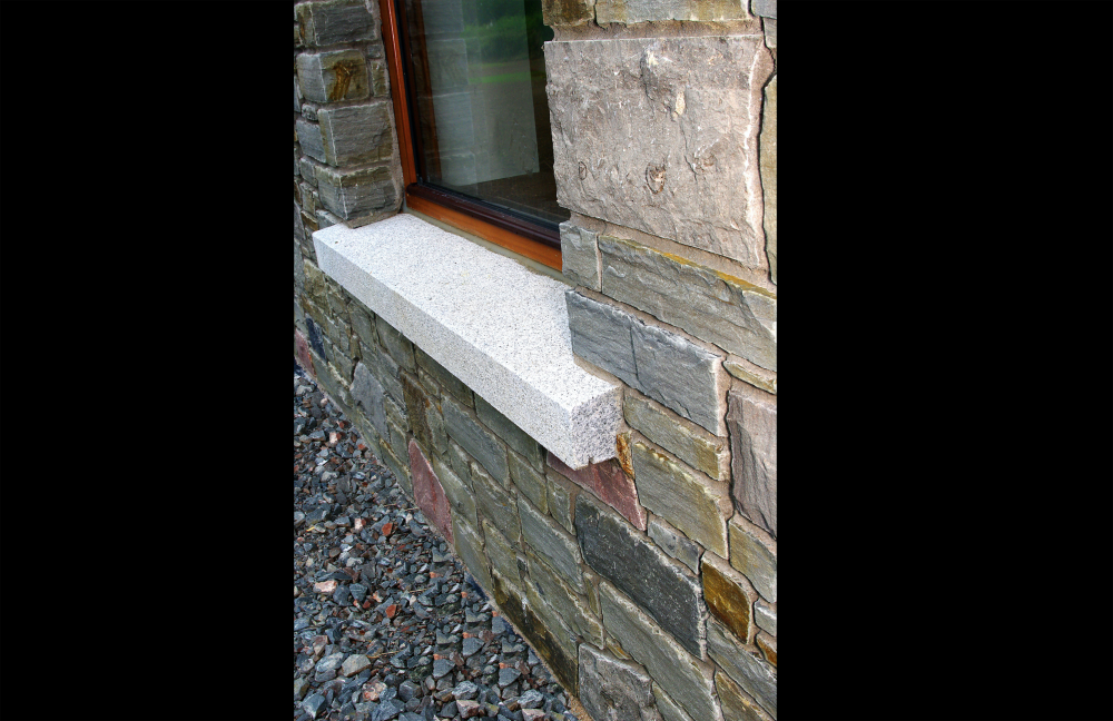 Portlaoise Sandstone with Armagh Pink and Grey Limestone finished with grey granite window cills.