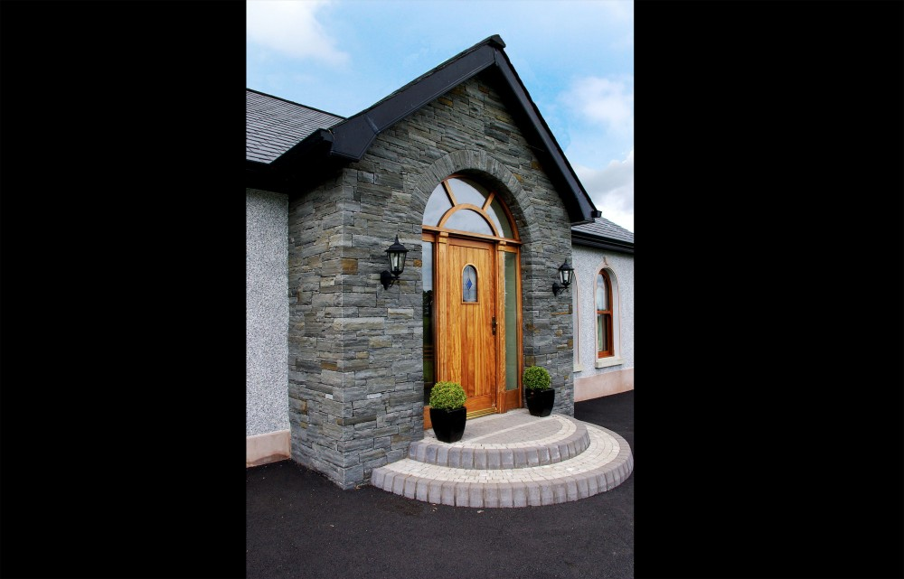 Dry built Liscannor stone porch with free standing door arch