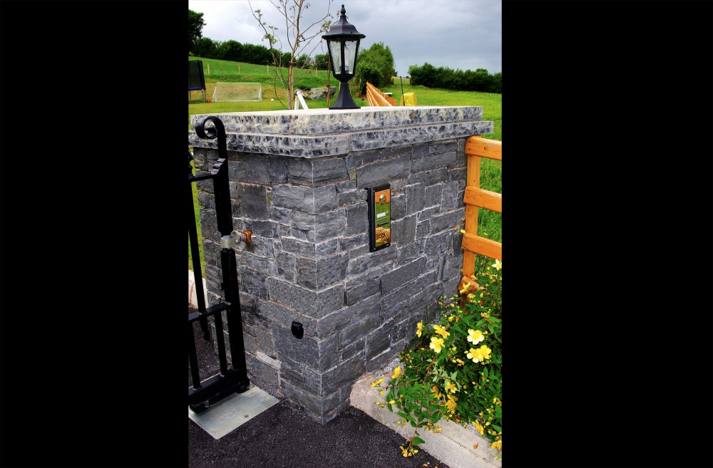 Dry built Liscannor stone pillar with built in keypad
