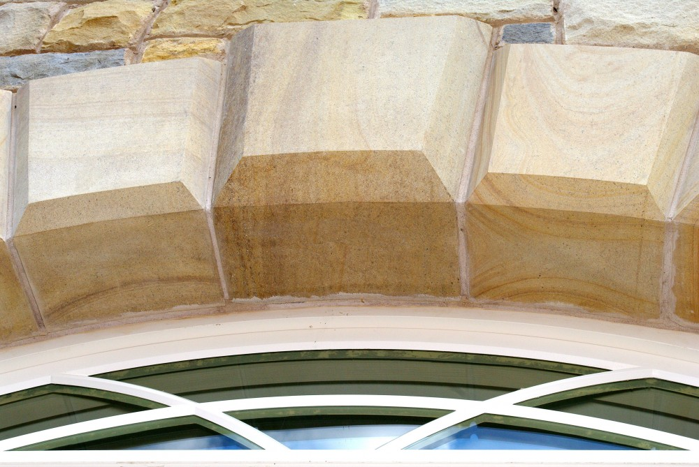 Sawn and polished sandstone with dominant keystone in centre